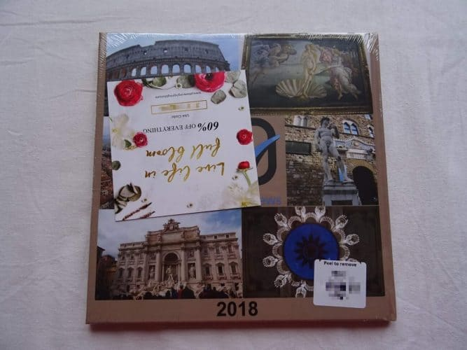 The Book in Its Wrapping With Coupon